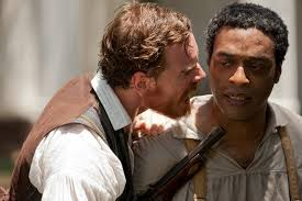 Michael Fassbender threatens Chiwetel Ejiofor in 12 Years a Slave.